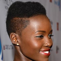 taglio capelli afro con crestina centrale